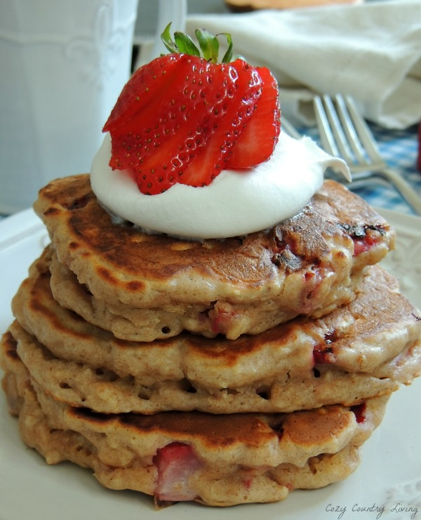 Strawberry Oatmeal Pancakes, moist, fluffy pancakes with juicy pieces of strawberries in every bite, old fashioned oats, buttermilk and whole wheat flour!